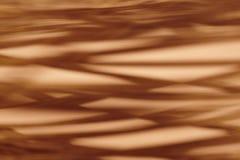 Warm tone abstract metallic background. Defocused Stock Image
