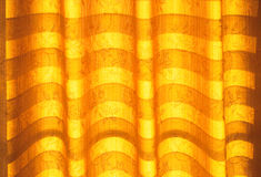 Warm tone blinds or curtains and abstract natural sunlight Stock Photography