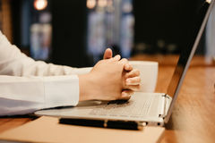 warm tone. business man hold hand placed on laptop. pen and note Royalty Free Stock Images