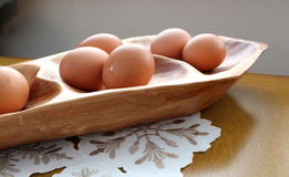 Warm-tone wood platter with fresh eggs Royalty Free Stock Image