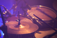 Warm toned live music photo background. Drummer plays on rock drum set. Close-up photo, soft selective focus Stock Photography