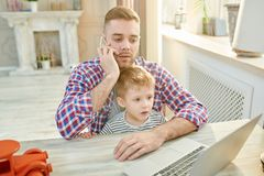 Father Babysitting Son stock photos