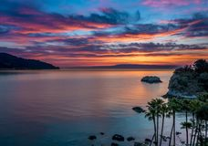 Colorful sunrise at the beach in Taormina, Sicily royalty free stock image