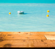 Warm turquoise ocean in caribbean by wooden decking Royalty Free Stock Image