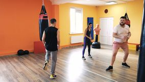 Warm up before the boxing training. Personal coaching. Trainer and private training. Special drills. Fitness club stock video footage