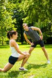 Warm up - couple exercising before jogging Royalty Free Stock Photography