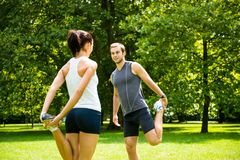 Warm up - couple exercising before jogging Royalty Free Stock Images