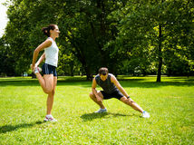 Warm up - couple exercising before jogging Stock Photo