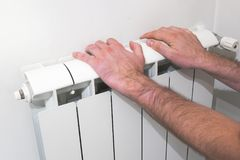 Warm up hands over hydraulic electric heater Royalty Free Stock Image
