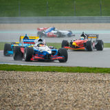 Warm up lap. ASSEN, NETHERLANDS - OCTOBER 19, 2014: Formula FA1 cars druing the warm up lap of the final wet race of the Acceleration 2014 tour stock photography
