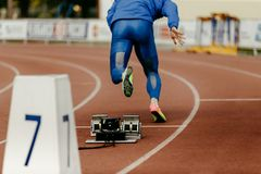 Warm-up running start male sprinter. Runner 200 meter race Royalty Free Stock Photo