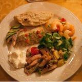 Warm Vegetables and fish  Salad. Warm fish Salad with Balsamic and Pesto Sauce Stock Image
