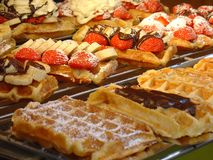 Warm waffles with fruits. Belgian sweets. Warm waffles with fruits Stock Images