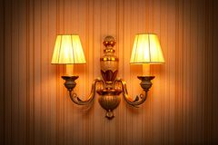 Warm wall sconce. The warm wall sconce background stock photos