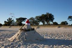 Warm weather Christmas Sandman at the beach Stock Photos