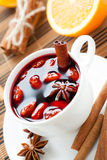 Warm wine with cinnamon and nuts, mulled wine Stock Images