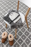 Warm winter clothes on a chair Stock Photography