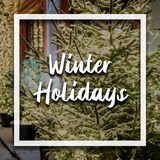 Warm winter holidays text on top of new year concept background f royalty free stock photography