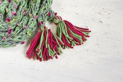 Warm winter scarf with  colored pompoms Royalty Free Stock Photo