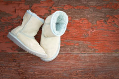 Warm winter sheepskin slippers Stock Photography