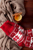 Warm winter socks and hot tea Royalty Free Stock Image