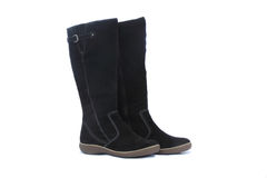 Warm winter womens black boots on white background Royalty Free Stock Images
