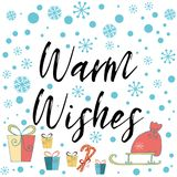 Warm wishes phrase decorated Christmas gifts, blue snowflakes Banner, card, congratulation, tag Stock Photo