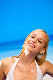 Warm woman in white bikini Stock Photography