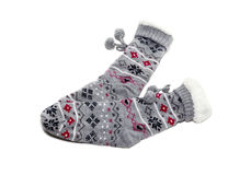 Warm women`s socks. Warm, winter women& x27;s socks with a pattern close up on a white background Stock Photos