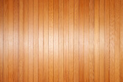Warm Wood Background. A warm wood panel background made of cedar with a soft highlight running through the middle Stock Photo