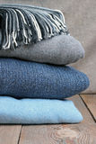 Warm wool clothing on a table Royalty Free Stock Images