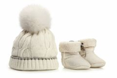 Warm woolen baby hat and booties over white Royalty Free Stock Photography