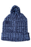 Warm woolen knitted hat with pompon Royalty Free Stock Photos