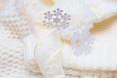 Warm woolen knitted hat and scarf with big white snowflakes Stock Photography