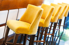 The warm yellow bar stools Royalty Free Stock Photography