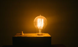 A warm yellow glare of bulb. Stock Images