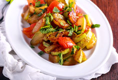 Warm zucchini and tomato salad with mint Royalty Free Stock Photography