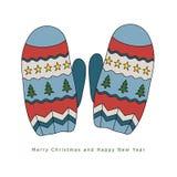 Warme Handschuhe des Winters mit einem Muster von Sternen und von Weihnachtsbäumen Lizenzfreies Stockbild