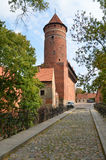 The Warmia Chapter Castle (Olsztyn, Poland). The Olsztyn castle was built in the Gothic style in the 14th century. At present it houses the Museum of Warmia and Royalty Free Stock Photos