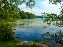 Landscape of Masuria in Poland. Warmian-Masurian region in northern Poland. View on Czos lake in MrÄ…gowo. HDR. High contrast photo. vivid colors stock image