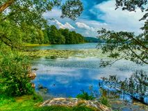 Landscape of Masuria in Poland. Warmian-Masurian region in northern Poland. View on Czos lake in MrÄ…gowo. HDR. High contrast photo. vivid colors royalty free stock images