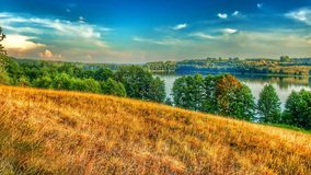 Landscape of Masuria in Poland. Juno Lake near Kiersztanowo. Warmian-Masurian region in northern Poland. View on Juno lake near the village of Kiersztanowo. HDR stock images