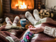 Warming And Relaxing Near Fireplace. Royalty Free Stock Images