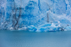The global warming problem. The warming of the atmosphere affects large frozen water supplies and leads to disappearing glaciers and sea level rise royalty free stock photo