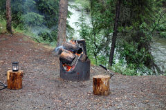 A warming campfire at a yukon campground in the springtime Stock Photo