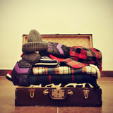 Warming clothes in a suitcase Royalty Free Stock Images