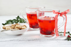 Warming cranberry tea on the boards Stock Photos