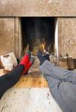 Warming feet Stock Image