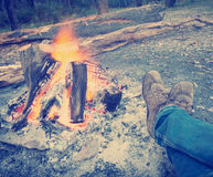 Warming Feet by Campfire Instagram Style Stock Images