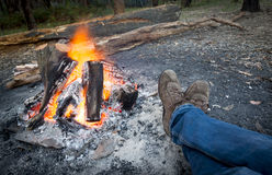 Warming Feet by Campfire Royalty Free Stock Image